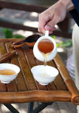 Traditional chinese tea ceremony accessories, selective focus on. Traditional chinese tea ceremony accessories (cups and a tea strainer pumpkin), selective focus Stock Photo