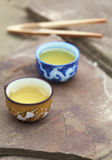 Traditional chinese tea ceremony accessories (tea cups) on the s. Tone table, copy space, selective focus on first cup Royalty Free Stock Image