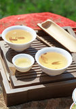 Traditional chinese tea ceremony accessories (tea cups). On the table Royalty Free Stock Image
