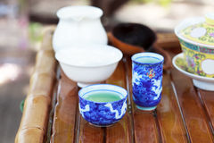 Traditional chinese tea ceremony accessories (tea cups). On the tea table, selective focus Royalty Free Stock Photography