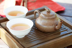Traditional chinese tea ceremony accessories (tea pot and cups w. Ith Feng Huang Puer tea) on the tea table Royalty Free Stock Photography