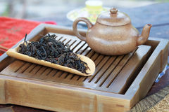 Traditional chinese tea ceremony accessories (tea pot and Feng H. Uang Puer tea) on the tea table Royalty Free Stock Photos