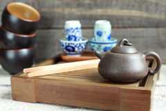 Traditional chinese tea ceremony accessories (tea pot and tea pa. Traditional chinese tea ceremony accessories (tea pot and blue tea pair) on the tea table Stock Photo