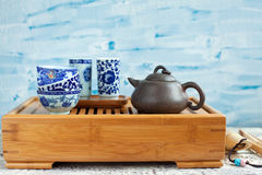 Traditional chinese tea ceremony accessories on the tea table. Traditional chinese tea ceremony accessories (tea pot) on the tea table Royalty Free Stock Images