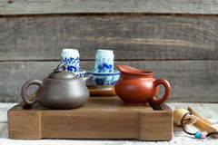 Traditional chinese tea ceremony accessories on the tea table. Traditional chinese tea ceremony accessories (tea pot and tea jar) on the tea table Royalty Free Stock Photo
