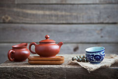 Traditional chinese tea ceremony accessories on the tea table. Traditional chinese tea ceremony accessories (tea pot and cups) on the wooden table Stock Photo