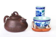 Traditional chinese tea ceremony accessories on a white bachgrou. Traditional chinese tea ceremony accessories (tea pot and tea pair) on a white bachground Stock Image
