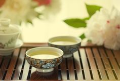 Traditional chinese tea ceremony Cun Fu Cha. With green tea. Horizontal, toned royalty free stock images