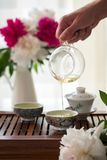 Traditional chinese tea ceremony Cun Fu Cha. With mans hand pouring tea. Vertical stock photo