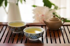 Traditional chinese tea ceremony Cun Fu Cha. With ceramic teapot royalty free stock photography