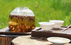 Traditional Chinese tea ceremony, tea leaves in boiling water in Stock Photos