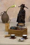 Traditional Chinese Tea Set with Statue Royalty Free Stock Photo