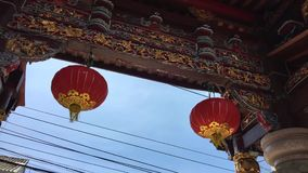 Traditional Chinese Temple Entrance with red Lanterns view with blue sky on background. In Phuket Town