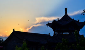 Traditional Chinese temple silhouetted in the sunset Royalty Free Stock Images