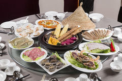 Traditional chinese tray food of seafood, produce, beef and pork royalty free stock photo
