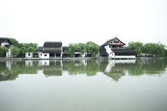 Traditional Chinese village along a river Stock Photography