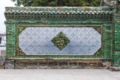 Traditional Chinese Wall With Details Of Glazed Green And Grey Tiles royalty free stock photography