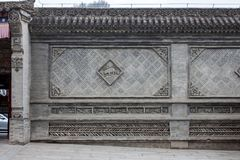 Traditional Chinese Wall With Details Of Glazed Green And Grey Tiles stock photo