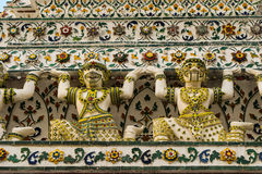 Traditional Chinese warrior sculptures. Famous temple of Wat Arun has many images of old Chinese soldiers that seem to be an mysterious hybrid between human and Royalty Free Stock Images