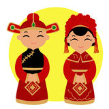 Traditional Chinese Wedding. Chinese bride and groom. Chinese Couple In Traditional Wedding Gown Stock Photos