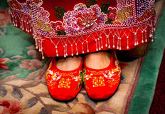 Traditional Chinese wedding shoes. Traditional red Chinese wedding shoes on the bride Stock Photography
