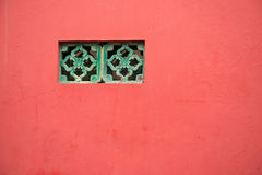 Traditional Chinese window on a red wall Royalty Free Stock Photos
