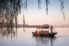 Traditional Chinese wooden boat with boatman Stock Photos