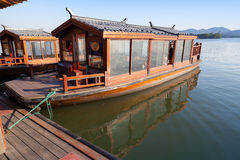 Traditional Chinese wooden boat with passengers Royalty Free Stock Photo