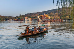 Traditional Chinese wooden recreation boat with boatman Stock Photo