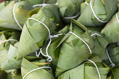 Traditional chinese zongzi. Glutinous rice balls wrapped in bamboo leaves Stock Image