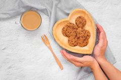 Traditional chocolate chip cookies on heart shape plate. Traditional chocolate chip cookies on heart shape plate royalty free stock image