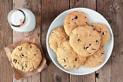 Traditional chocolate chip cookies and milk on rustic wood Royalty Free Stock Image