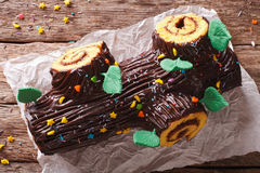 Traditional chocolate Christmas log roll close-up. Horizontal to Stock Photography