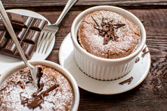 Traditional chocolate souffle. French traditional chocolate souffle in white plate Royalty Free Stock Photography
