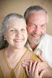 Traditional Christian Marriage - Seniors. Portrait of beautiful happy senior couple in a traditional Christian marriage.  She is wearing a cross Royalty Free Stock Photography