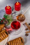 Traditional Christmas apple punch with cinnamon and honey on a table of candles background royalty free stock photo