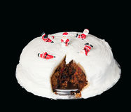 Traditional Christmas Cake. A traditional british xmas cake with small toy Santa playing on the icing royalty free stock photo