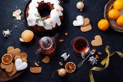 Traditional christmas cake with dried fruits soaked in rum and sugar glaze Stock Photos