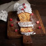 traditional Christmas cake stollen cut into pieces royalty free stock images