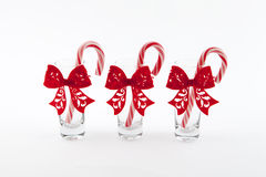 Traditional christmas candies cane. Three traditional christmas candies cane in the glass on a white background Royalty Free Stock Image