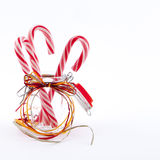 Traditional christmas candies cane. Three traditional christmas candies cane in the glass on a white background Stock Photos