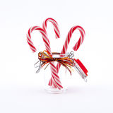 Traditional christmas candies cane. Three traditional christmas candies cane in the glass on a white background Stock Photo