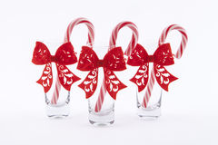Traditional christmas candies cane. Three traditional christmas candies cane in the glass on a white background Stock Image