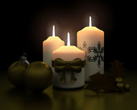 Traditional christmas candle and decorations Stock Images