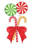 Traditional christmas candy canes and lollipops Stock Photos