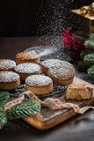 Traditional Christmas cookies with almonds and sesame on dark wooden background with copy space royalty free stock images