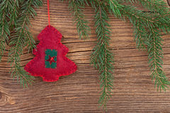 Traditional Christmas decoration with fir branch on wooden background Royalty Free Stock Image
