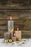 Traditional christmas decoration with four beige burning advent Royalty Free Stock Photo