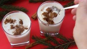 Traditional Christmas drink eggnog with grated nutmeg and cinnamon.