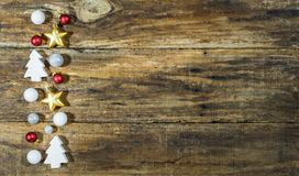 Traditional Christmas elements border on wooden background Stock Photography